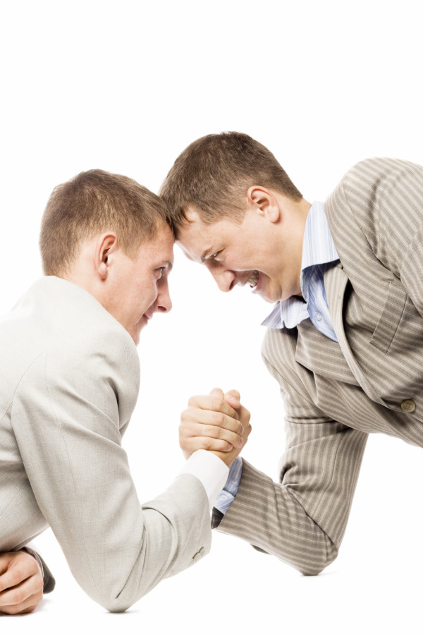 two men wrestling with arms